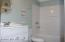 Guest Bathroom on First Floor. Opens to Hall and to Third Bedroom