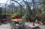 """Out door screened in """"bird cage"""" area with a Tile Floor."""