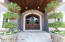 "The Entrance portico is supported by Travertine Marble Columns & 9' Antique French Oak doors 3"" thick."