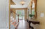 Welcoming Entry with Travertine Floors