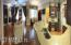 Panaromic view of living room, kitchen, and sitting room