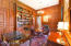 Wood Paneled walls, Built-ins, wet bar, fireplace