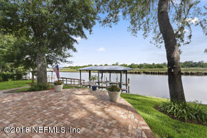 Fabulous dock with 13,000 lb. boat hoist with remote control, and 30 to 50 amp. power service on the dock. Fabulous location on the Ribault river. Beautiful landscaping with pavered patio to enjoy the views!