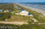 Almost an acre overlooking a long sandy beach