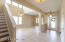 Tile throughout downstairs in the main areas. Foyer with formal dining and living room.