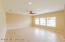 Spacious Family Room with recessed lighting and pre-wired surround sound.