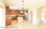 42'' cabinets, stainless steel appliances, walk-in pantry, food prep area with sink.