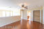 Laminate flooring and extra closet/storage space in loft area.