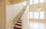 Wood flooring and handrail along staircase.