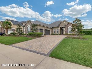 Coastal Oaks luxury living features 3 Car garage, waterfront with salt water pool