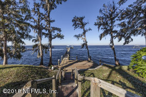 This custom riverfront sanctuary offers a private perspective with 250 feet on the St. Johns River.