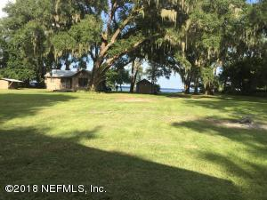 1.711 Acre site on St. Johns River with 3 rental units and accessory buildings