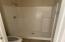 Master bathroom shower and latrine