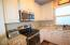 Stainless steel appliances, built-in microwaves, granite counter tops.