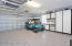 Owner has added high end storage cabinetry, work bench & epoxy flooring