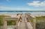 Private beach access and sun deck.