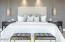 Master bed with sconces