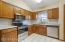 Updated kitchen with brand new stainless steel appliances, countertops and backsplash!
