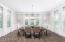 Exquisite Dining Area with Picture & Crown Molding - Bright and Inviting!