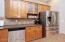 Nice tile backsplash & glass front cabinets
