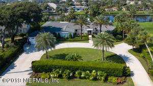 ...a nearly 3/4 acre tropical oasis with panoramic lawn, pool and lagoon views!