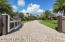 Invites you to come this way. Over 100 palms can be found on this landscaped estate.