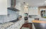 For those who enjoy cooking, this kitchen satisfies every culinary and discriminating chef.