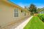 Paver walkway alongside the home