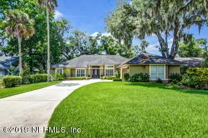This luxurious 4 bedroom 3 bath ranch with stunning lake views is a dream home in a high end community Players Club that is home to PGA's, The Players Championship.