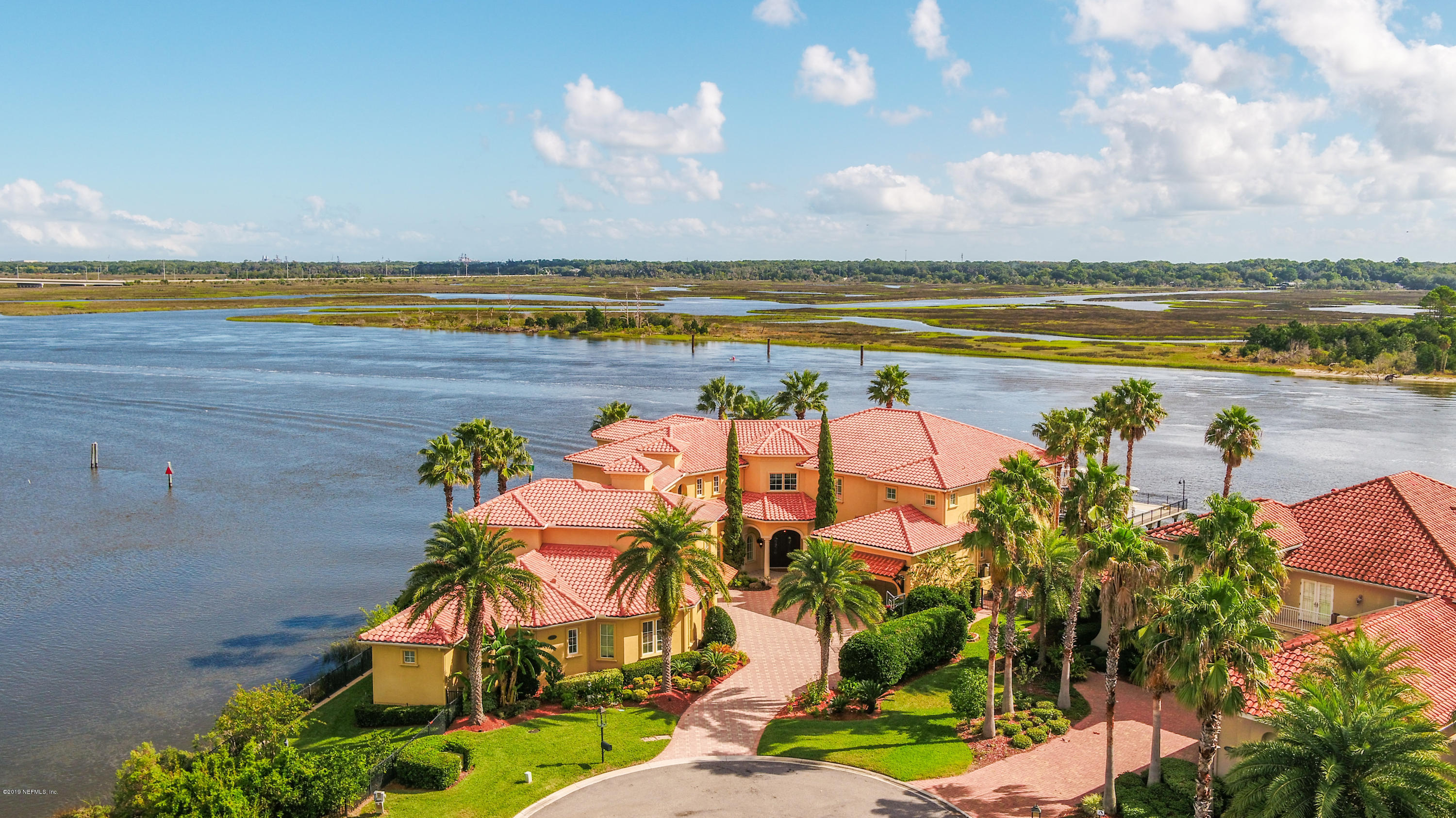 LISTED UNDER APPRAISED VALUE! You have seen this estate and you have dreamed about how you could be yours. Now your dreams can come true. As you drive down the private oasis of ''The Island'' to your grand  home; you see beautiful Intracostal Waterway views to your right and to your left breathtaking nature. Privacy has never felt so exclusive as you enter your magnificent residence. Is it a boat and jet ski day? A soak up the sun day? Will you have a movie day? Or a pool day? How does it sound to have a lot of everything? This home offers it all and more. You truly can have it all.Luxury finishes coupled with functionality to make everyday life truly just another day in paradise.