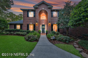 Magnificent Waterfront Home that has it all! All Brick with architectural detail, wood floors, updated chefs kitchen, pool, lush landscaping with yard overseeing the Boathouse and Waterfront.