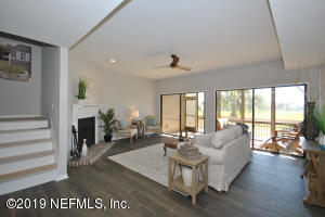The open family and dining areas overlook a large screened porch.
