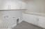 Laundry Room with storage cabinetry and folding quartz counter