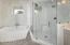 Masterbathroom with soaking tub and seamless glass shower