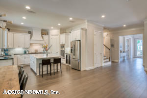 Large kitchen island with wine refrigerator to the right