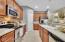 Pantry- neutral tile flooring and backsplash -Corian countertops.