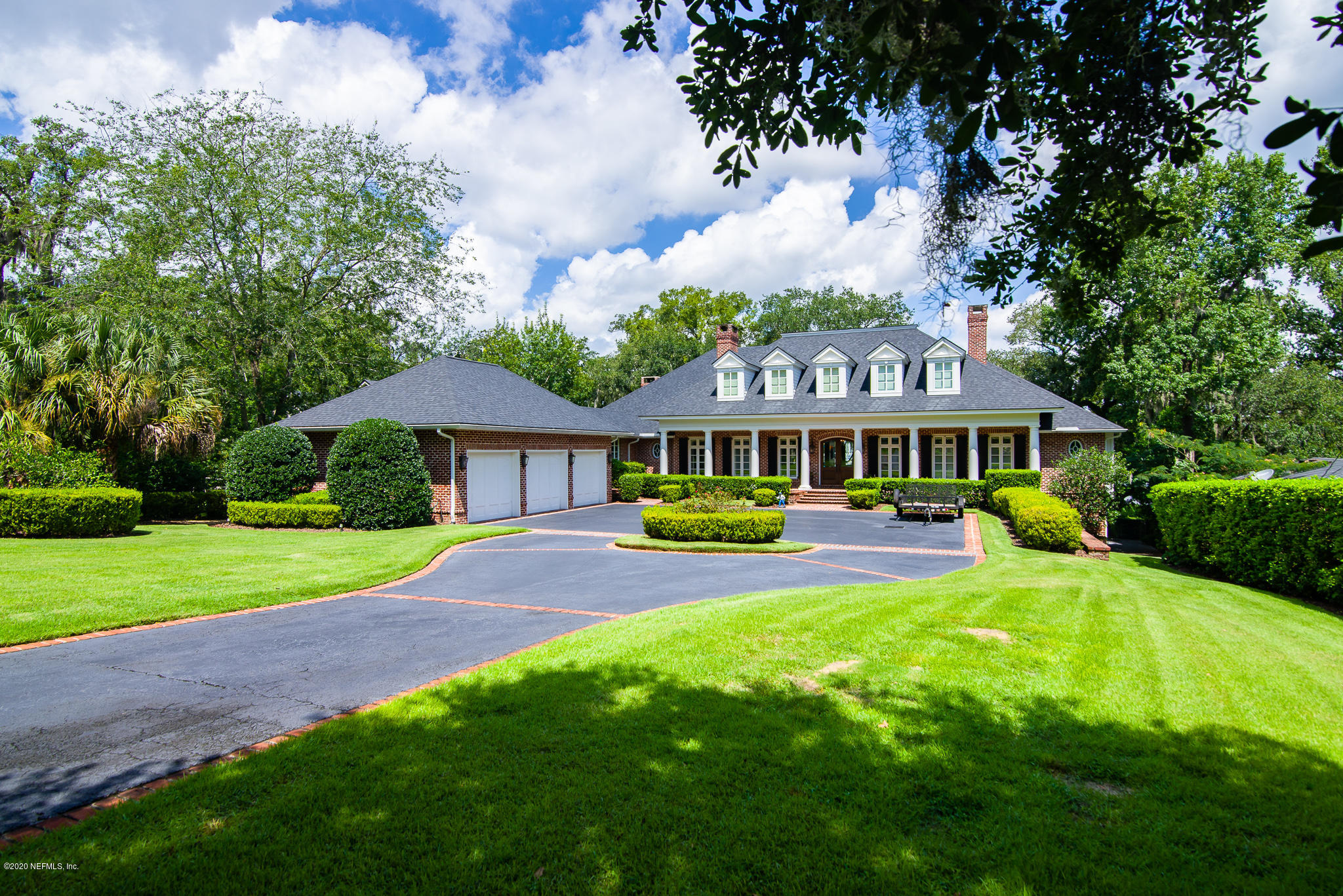This house and setting will take your breath away and leave you speechless! This meticulously built and maintained  home has it all!  High ceilings, superb architectural details and moldings,   wide planked stained pine floors ,each bedroom has its own bath and walk in closet, chefs kitchen, the marble floors in the master bath are heated and the towel holders too!  Steam shower. movie theatre room, bonus room, home office, laundry up and downstairs, , summer kitchen with fireplace, pool, hot tub and  dock  There is even a garage ''underground'' for the golf cart and boat toys!  A good time to be had by all  at this fabulous house! Buyer to verify all measurements.