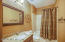 Full Hall bath offers plenty of counter space and linen closet for storage.