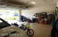 Garage features epoxy coated floors.