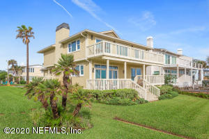 A side & back view of home with plentiful outdoor and yard space. Convenient walkover to beach adjoins