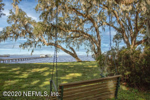 Park like setting offers more than 250' bulkheaded with incredible river views. Featuring gracious ranch style home, dock & lifts.
