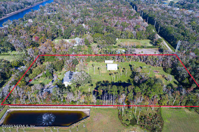 An idyllic setting combined with unrivaled land versatility creates this nature and horse lovers dream located just minutes from the sands of Ponte Vedra Beach. Consisting of two separately deeded parcels, this 5 acre offering is one that is unheard of in close proximity to coastal areas of the United States. The northernmost parcel consists of 4 acres of land with a home that was renovated from the studs out in 1993. This home offers two bedrooms and two full baths with 2556 sq ft of conditioned space.  In the back of this property lies a barn ready for up to 6 horse stalls, a paddock, and a pond positioned on the southern side of the parcel.  The home on the southern one acre parcel was built in 2000, consisting of 4 bedrooms and 2 full baths with 2450 sq ft of living space.