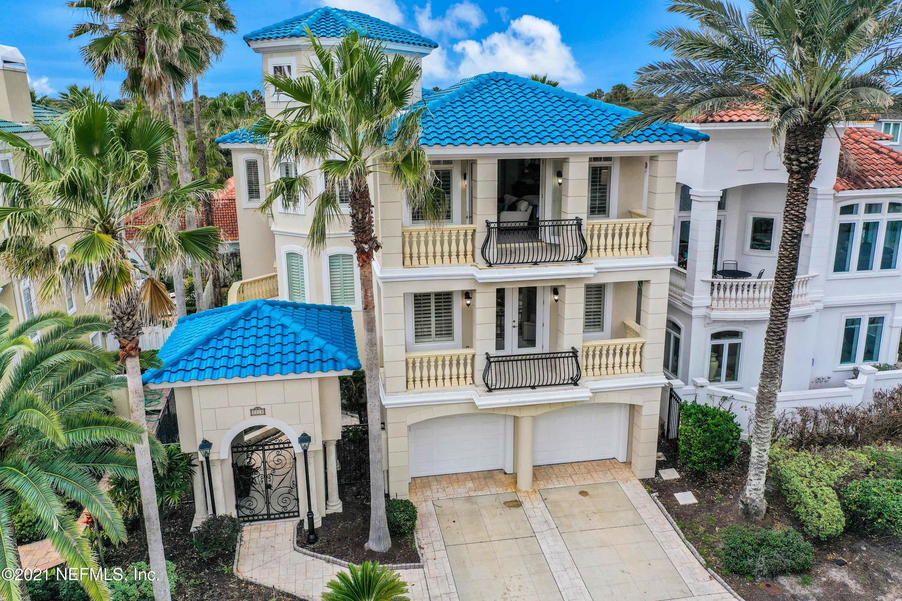 Magnificent Mediterranean style home with OCEAN VIEWS! This 3 story, 4 Bed/5 full bath, home in Atlantic Beach features 3 OCEAN FACING BALCONIES, a Spanish Style Tile roof, 4-CAR garage, NEW A/C units, Murano Italian lighting, and an EXQUISITE BRONZE FOUNTAIN in the courtyard entry. Relax by one of the two gas fireplaces (located in the master suite & living room), or work in style from the luxurious office boasting CHERRY WALLS AND CABINETRY. The Master Suite is it's own oasis with a large built in wine rack, personal Refrigerator, & separate sitting area w/ beverage station. The Kitchen features GRANITE COUNTERS, large food prep island complete with sink, Gas Stove, Sub-Zero Refrigerator, and a Wine Cooler. This is a must see home, so schedule your appointment today!