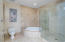 Spacious bathroom with separate tub and shower