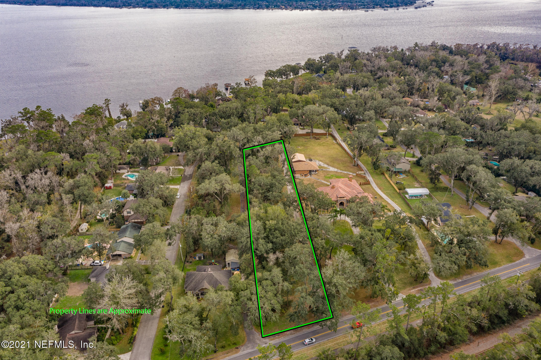 Nestled off Doctors lake Drive, this property offers a chance to build your dream home in a high sought after area. With beautiful mature trees and a water view of Doctors Lake its ready for its new build site and owners. Only minutes away from Top Rated Schools including St. Johns Country Day.