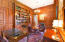 Wood Paneled walls, built-ins, wet bar, fireplace