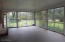 Large glassed-in porch off the Living Room with view of front lawn.