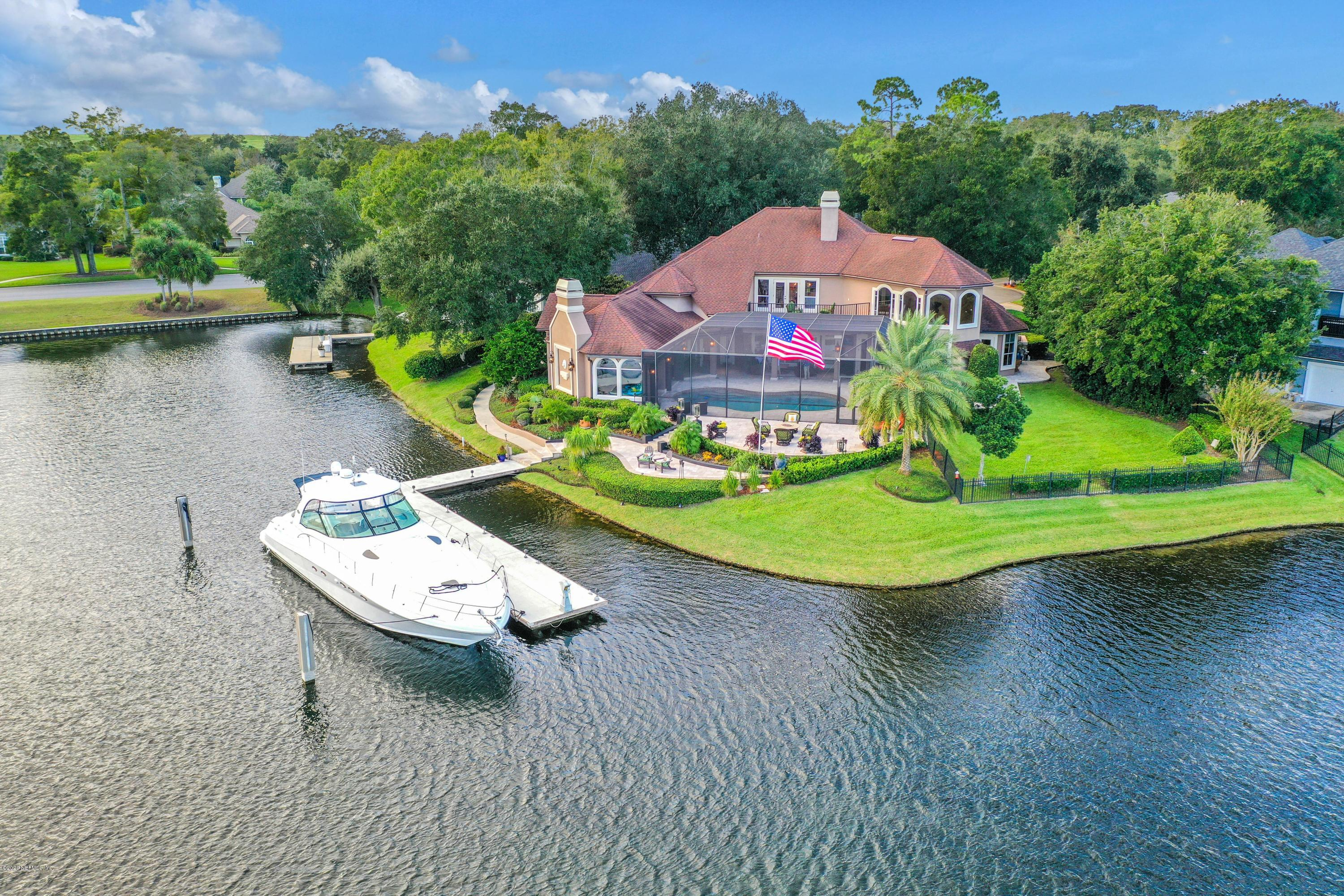 "Welcome to Emerald Cove, a mariner's masterpiece. This modern-Tuscan inspired home is situated on 237 feet of waterfront in Queen's Harbour Yacht and Country Club.  Located on the highly elusive lagoon just off the intracoastal waterway, this spring-fed basin is the only of its kind on the eastern seaboard.  Protected by a 110-foot lock and a Harbormaster, this unique circumstance creates a safe-harbor for valuable vessels by keeping them safely elevated above the tide.Inside this masterpiece you'll find highly-detailed wood and stonework through-out along with plenty of windows with picturesque views that fill the residence with an abundance of natural light.  The gourmet kitchen is fitting for the resident chef and comes equipped with high-end appliances and thoughtful conveniences. For the most ambitious collector there is a 750+ bottle wine cellar perfectly placed off the recreation room which offers stunning views of the lagoon.  The true jewel of the home is the outdoor living where as much detail went outside as did the inside, starting with a distinctive ""post and beam"" lifestyle pavilion. Situated off the pool overlooking the lagoon, this creative space offers over 4,000 square feet of relaxation and helps blend the interior and exterior areas by offering its own private jacuzzi with fireplace, a summer kitchen and pizza oven and finally, its own teppanyaki grill.  The landscape architecture maximizes the grounds and allows for multiple terraces to either step-away for an intimate candlelit dinner or wake up and re-energize with sunrise yoga on the natural lagoon."