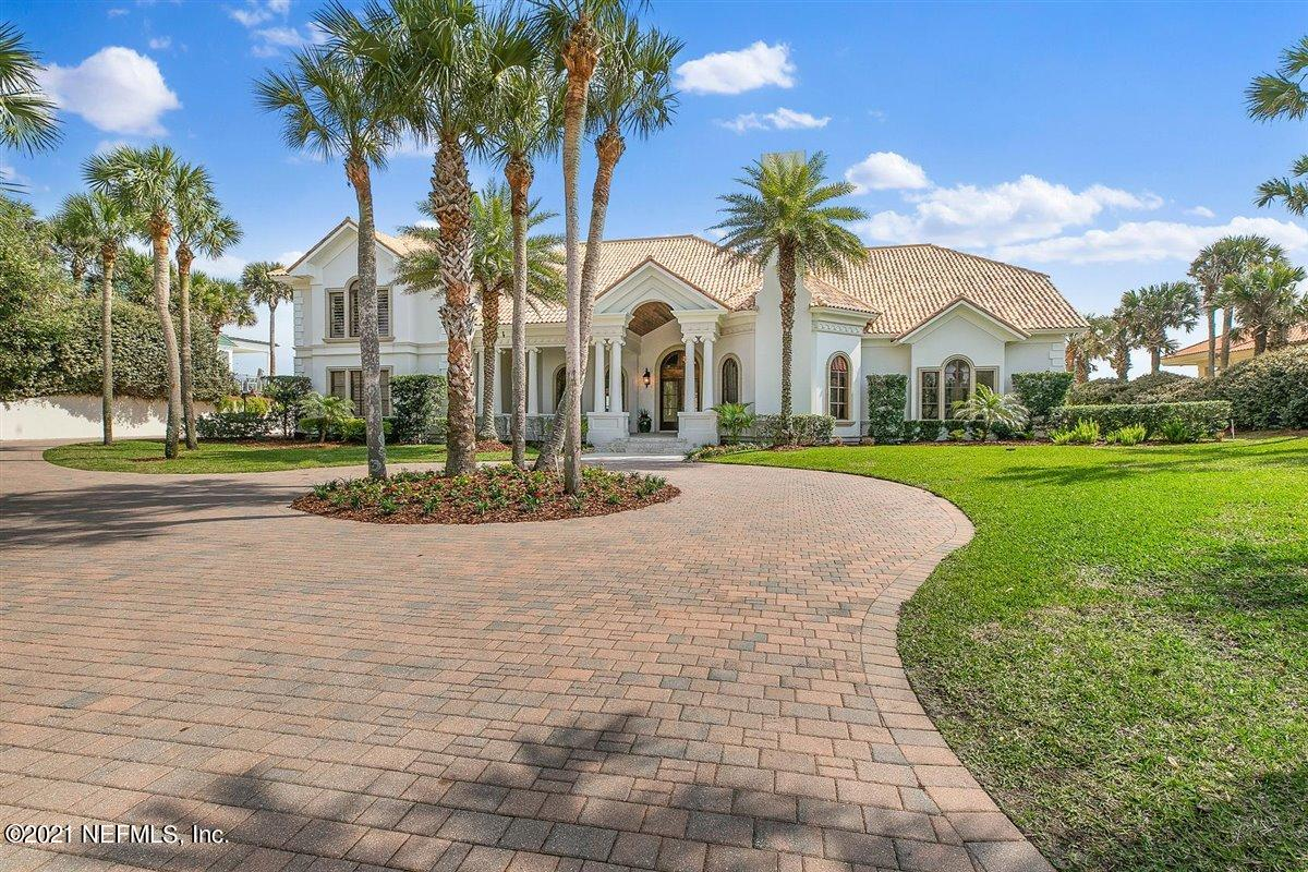 Beautiful elevated oceanfront estate on a private stretch of PV Blvd. Attention to detail and custom features throughout including a Ludowici roof, marble floors and impact windows/doors to name a few. From the arched doorways to the octagonal rooms this home was built to take advantage of the view and natural light. Downstairs boasts a gorgeous oversized master suite with it's own sitting room, gym and office. Large kitchen w/ Viking appl package, sub-zero refrigerator and wet bar opens to the family room overlooking the pool perched 28' above the spectacular sweeping ocean views.  Upstairs features a guest suite with full kitchen and private elevator access, 3 additional bedrooms all with ensuite and a bonus room. Come take a look at this stunning piece of Ponte Vedra Beach!