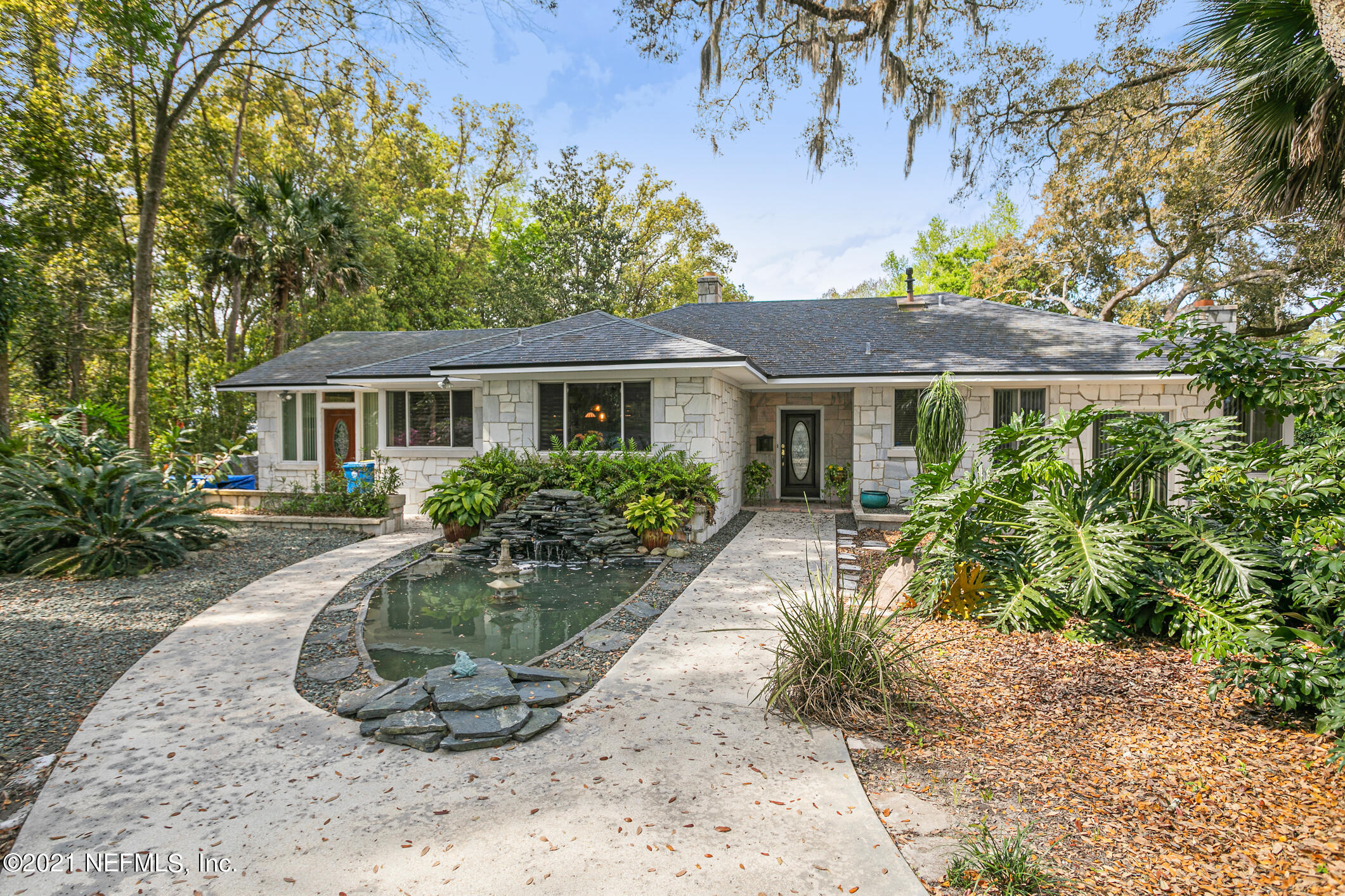 Charm personified in this hidden treasure. Tucked at the end of a non-assuming street you will find this hidden Gem. The gorgeous and lush landscape surrounds the home all the way to the river. Newer built pool and dock is like living in paradise and being on vacation every day. The central location is convenient and close to all Jacksonville has to offer. The open floor plan and spacious rooms offer natural sunlight as every room is filled with windows and doors leading to the wonderful outside.Fabulous kitchen offers gas cooktop, Subzero refrigerator & freezer, beautiful cabinetry and much more. 3rd bedroom now used as office space. Detached garage includes laundry room & bath along with upstairs apartment with efficiency kitchen & bath. Bulkheaded, refurbished dock w/lift.